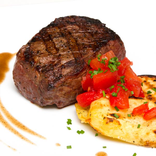Grilled Guinness-Marinated Sirloin Steaks with Chived Potatoes and Tomatoes